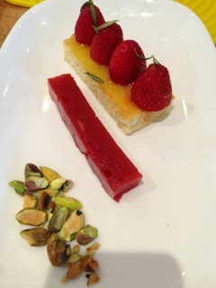 Piccino's olive oil cake w/ rosemary lemon curd, strawberries, fried rosemary, strawbery gelee and roasted pistachios