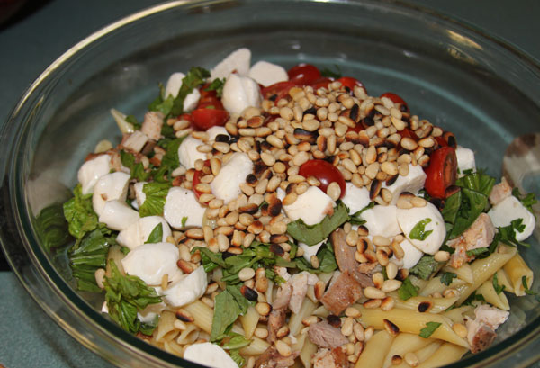 Caprese salad with chicken, penne, and pine nuts