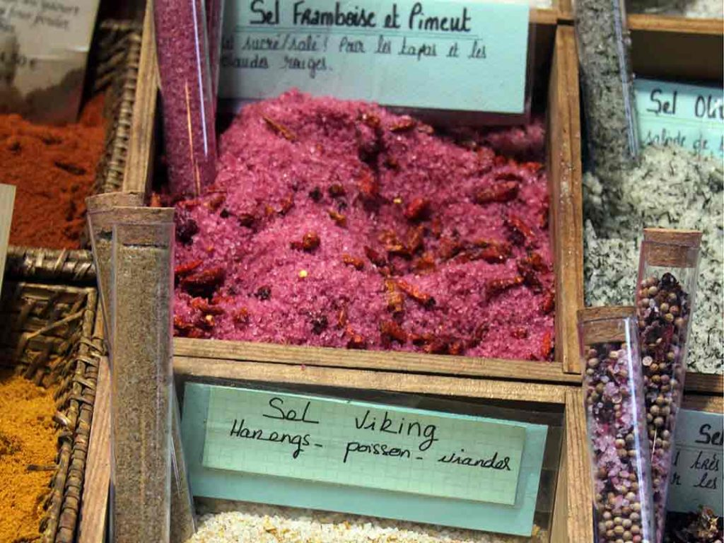 Small wooden crate filled with raspberry colored salt blend