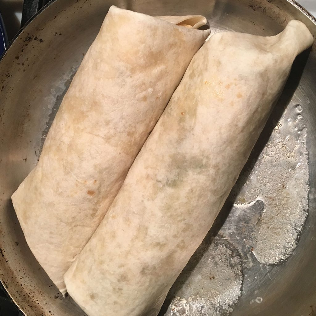 Rolled flour tortillas in a skillet